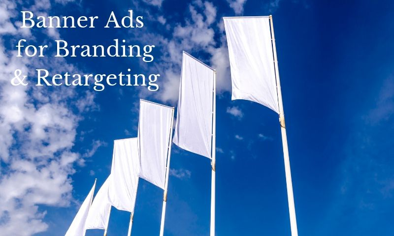 banner advertising for branding white flags flying against blue sky and clouds